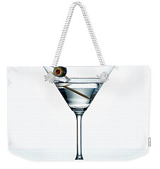 Dry Martini With Green Olive In Cocktail Glass Over White Backgr Weekender Tote Bag