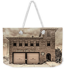 Weekender Tote Bag featuring the photograph Duran Fire Dept by Lou Novick