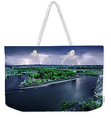 Weekender Tote Bag featuring the photograph East Montana Lightning Storm by Leland D Howard