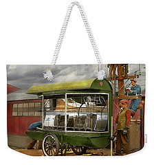 Weekender Tote Bag featuring the photograph Electrician - Linemen - Installing Search Lights 1929 by Mike Savad