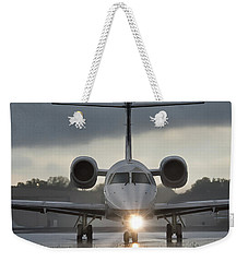 Weekender Tote Bag featuring the photograph Embraer 145 by Guy Whiteley