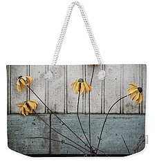 Weekender Tote Bag featuring the photograph Fake Wilted Flowers by Steve Stanger