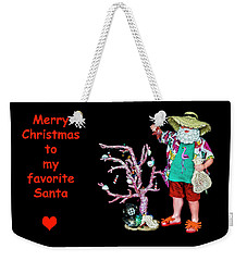 Weekender Tote Bag featuring the photograph Favorite Tropical Santa Decorating The Christmas Tree by Kay Brewer