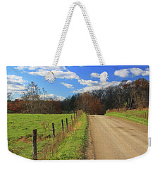 Weekender Tote Bag featuring the photograph Fence And Country Road by Angela Murdock