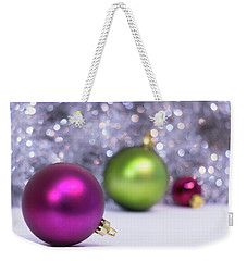 Weekender Tote Bag featuring the photograph Festive Scene For Christmas With Xmas Balls And Lights In Backgr by Cristina Stefan