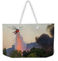 Weekender Tote Bag featuring the photograph Fighting Fire With Fire by Lynn Bauer