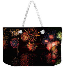Weekender Tote Bag featuring the digital art Fireworks Reflection Panorama by OLena Art Brand