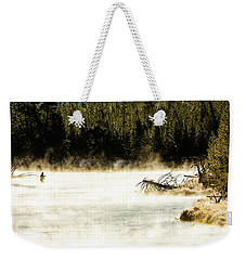 Weekender Tote Bag featuring the photograph First Fish by Pete Federico