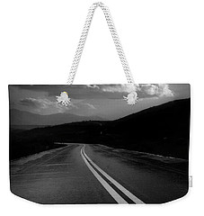Weekender Tote Bag featuring the photograph Flight Path by John Rodrigues