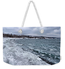 Weekender Tote Bag featuring the photograph Floating Ice by Susan Rissi Tregoning