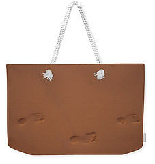 Weekender Tote Bag featuring the photograph Foot Prints In Sand by Stuart Manning