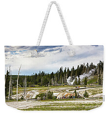 Weekender Tote Bag featuring the photograph Fuming Geysers In Yellowstone National Park by Tatiana Travelways