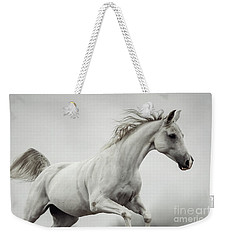 Weekender Tote Bag featuring the photograph Galloping White Horse by Dimitar Hristov