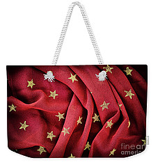 Weekender Tote Bag featuring the photograph Gold Stars Red by Tim Gainey