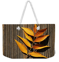 Weekender Tote Bag featuring the photograph Golden Autumn Leaves On Wood by Debi Dalio