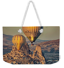 Weekender Tote Bag featuring the photograph Golden Hour Balloons by Francisco Gomez