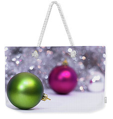 Weekender Tote Bag featuring the photograph Green And Fuchsia Christmas Balls And Lights In Background. Wint by Cristina Stefan