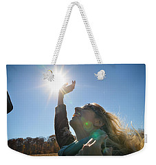 Weekender Tote Bag featuring the photograph Handful Of Sunshine by Carl Young