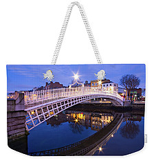 Weekender Tote Bag featuring the photograph Ha'penny Bridge At Blue Hour by Barry O Carroll