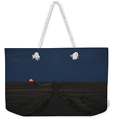 Weekender Tote Bag featuring the photograph Harvest Moon 1 by Carl Young