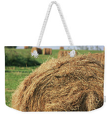 Weekender Tote Bag featuring the photograph Hay Bail Closeup by Tatiana Travelways