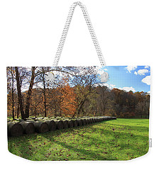 Weekender Tote Bag featuring the photograph Hay Bales On An Autumn Day by Angela Murdock