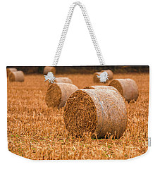 Weekender Tote Bag featuring the photograph Hay Rolls by Dan Sproul