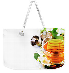 Herbal Green Tea With Jasmine Flower In Transparent Teacup Borde Weekender Tote Bag