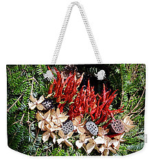 Weekender Tote Bag featuring the photograph Holiday Peppers by Don Moore
