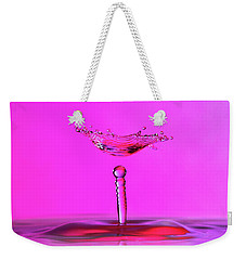 Weekender Tote Bag featuring the photograph Hovering Collision And Beaded Column In Pink by SR Green