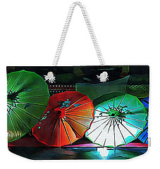 Weekender Tote Bag featuring the photograph Illuminated Oriental Parasols by Dorothy Berry-Lound