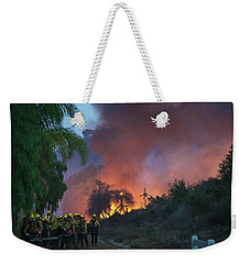 Weekender Tote Bag featuring the photograph In The Line Of Duty by Lynn Bauer