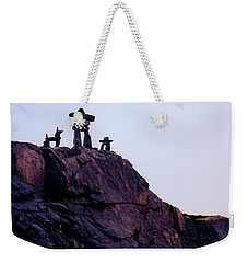 Weekender Tote Bag featuring the photograph Inukshuk Family In Labrador, Canada by Tatiana Travelways
