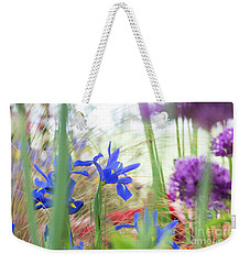 Weekender Tote Bag featuring the photograph Iris Hollandica 'professor Blaauw' On Display by Tim Gainey