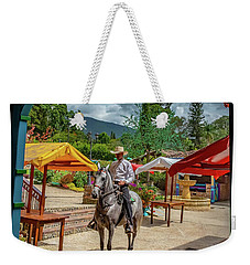 Weekender Tote Bag featuring the photograph La Mayoria by Francisco Gomez