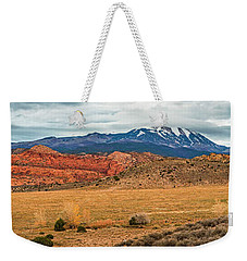 Weekender Tote Bag featuring the photograph La Sal Mountains by Andy Crawford