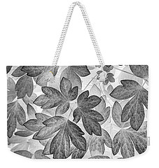 Weekender Tote Bag featuring the photograph Leaves Black And White Plant Pattern by Christina Rollo