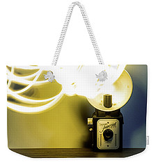 Weekender Tote Bag featuring the photograph Lights, Camera, Action by Melissa Lane