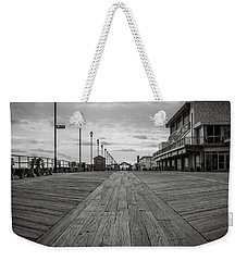 Weekender Tote Bag featuring the photograph Low On The Boardwalk by Steve Stanger