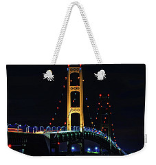Weekender Tote Bag featuring the photograph Mackinac Bridge Lit Up by Dan Sproul