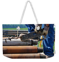Weekender Tote Bag featuring the photograph Metal On Metal by Carl Young