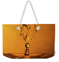 Weekender Tote Bag featuring the photograph Molten Caramel Water Drop Collision by SR Green