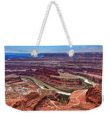 Weekender Tote Bag featuring the photograph Moon Over Deadhorse Point by Andy Crawford