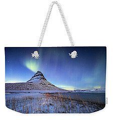 Weekender Tote Bag featuring the photograph Northern Lights Atop Kirkjufell Iceland by Nathan Bush