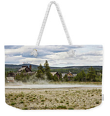 Weekender Tote Bag featuring the photograph Old Faithful Inn Hotel In The Yellowstone National Park by Tatiana Travelways