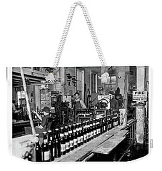 Weekender Tote Bag featuring the photograph Olympia Brewing Company Bottling Line, 1920ca by Joe Jeffers