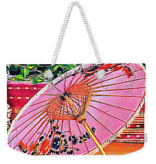Weekender Tote Bag featuring the photograph Oriental Pink Parasol by Dorothy Berry-Lound