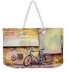 Weekender Tote Bag featuring the photograph Ostrad Bicycle by Craig J Satterlee