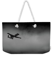 Weekender Tote Bag featuring the photograph Out Of The Clouds - A-10c Thunderbolt by Doug Camara