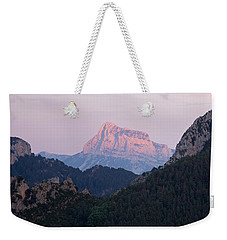 Weekender Tote Bag featuring the photograph Pena Montanesa Glowing Red by Stephen Taylor